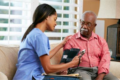 elderly having hes blood pressure check