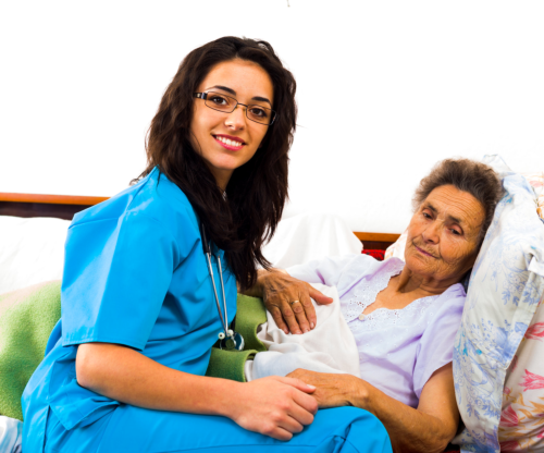 nurse taking care of an elderly woman in bed